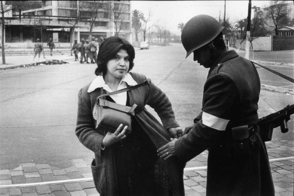 Chili, Santiago september 1973. A woman is being searched on the street during the military coup.