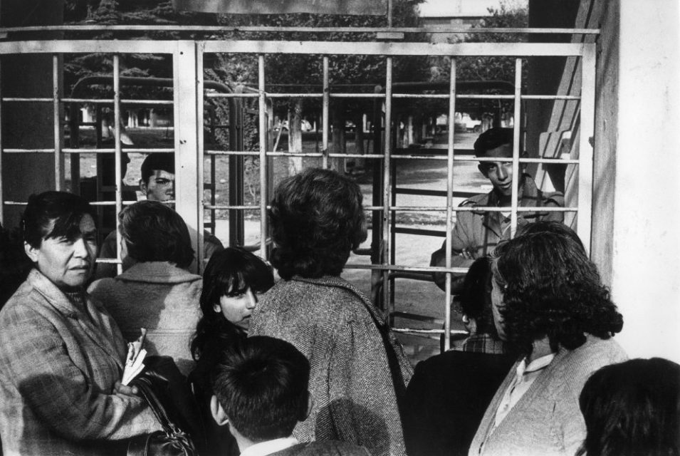 Chili, Santiago, september 1973. Several days after the military coup. People gather at the sheds where friends and family members are being held, trying to get some information.