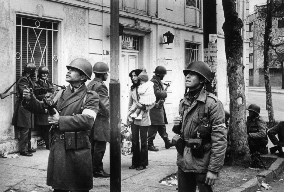 Chili, Santiago, september 1973. Several days after the military coup. Mother and her child amongst soldiers on the street.