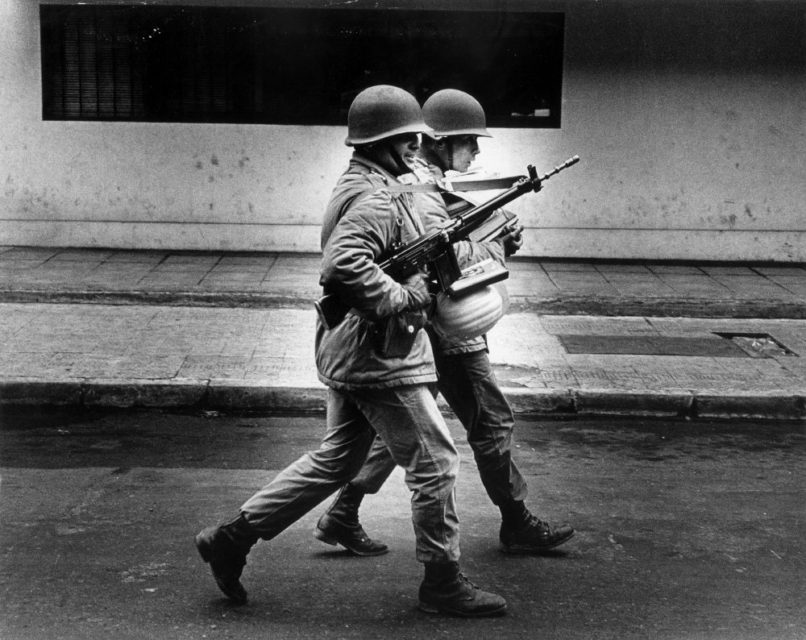 Chili, Santiago, september 1973. Several days after the military coup. Soldiers are carrying books and papers to be burned later on.