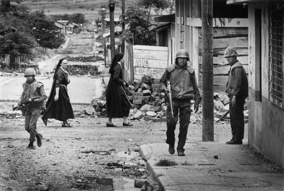 Nicaragua, Esteli, 1978. Street view with soldiers and nuns.