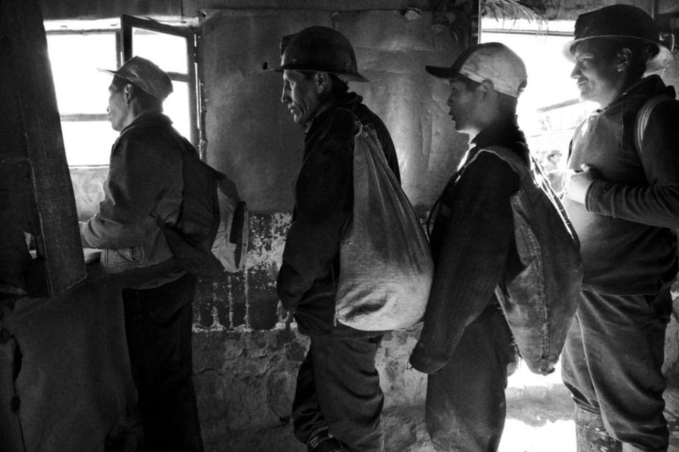 Miners have breakfast before entering the mines.