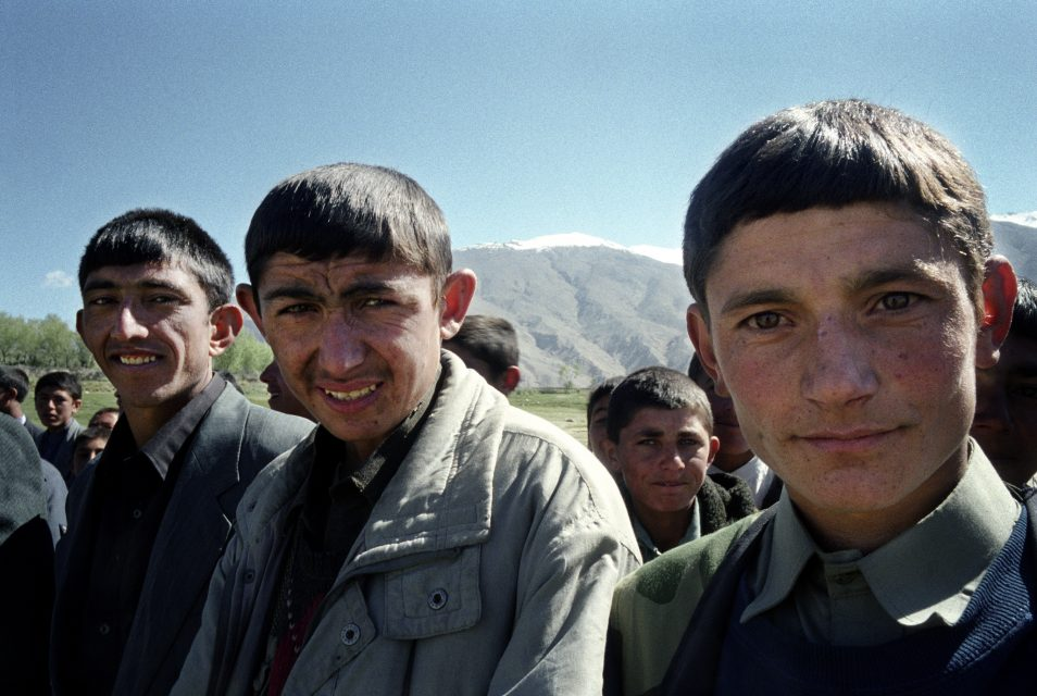 ISHKASHEM, BADAKSHAN, AFGHANISTAN: JUNE 2004: School children standing in line for the festivities for