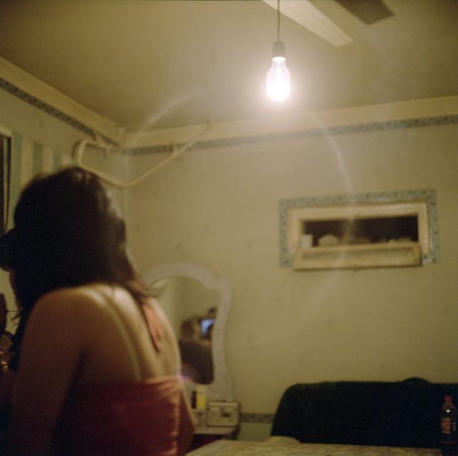 OSH, 2009. An Uzbek girl working as a prostitute in Jetigen Sauna.