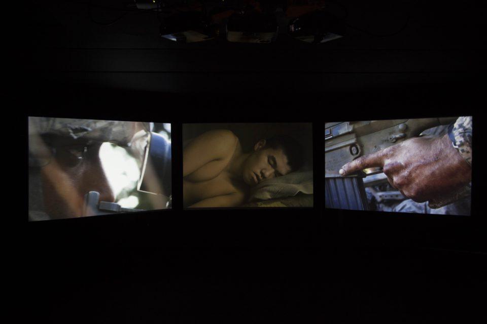 Three screen video installation 'Sleeping Soldiers' by Tim Hetherington