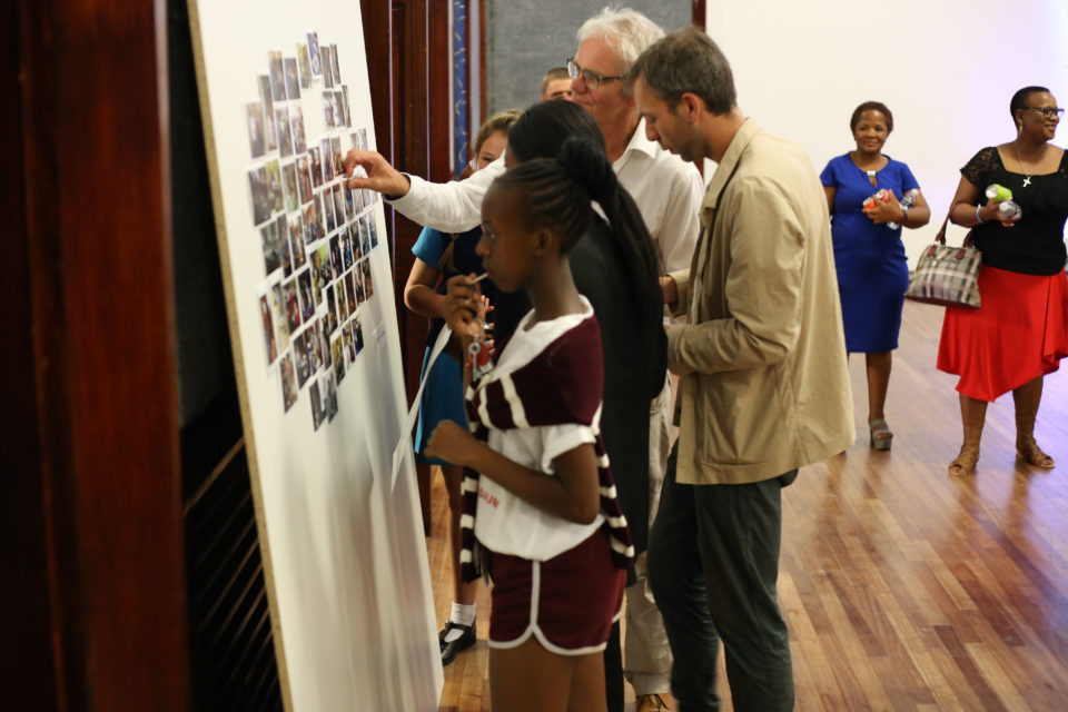 Ad van Denderen and some students at the exhibition.