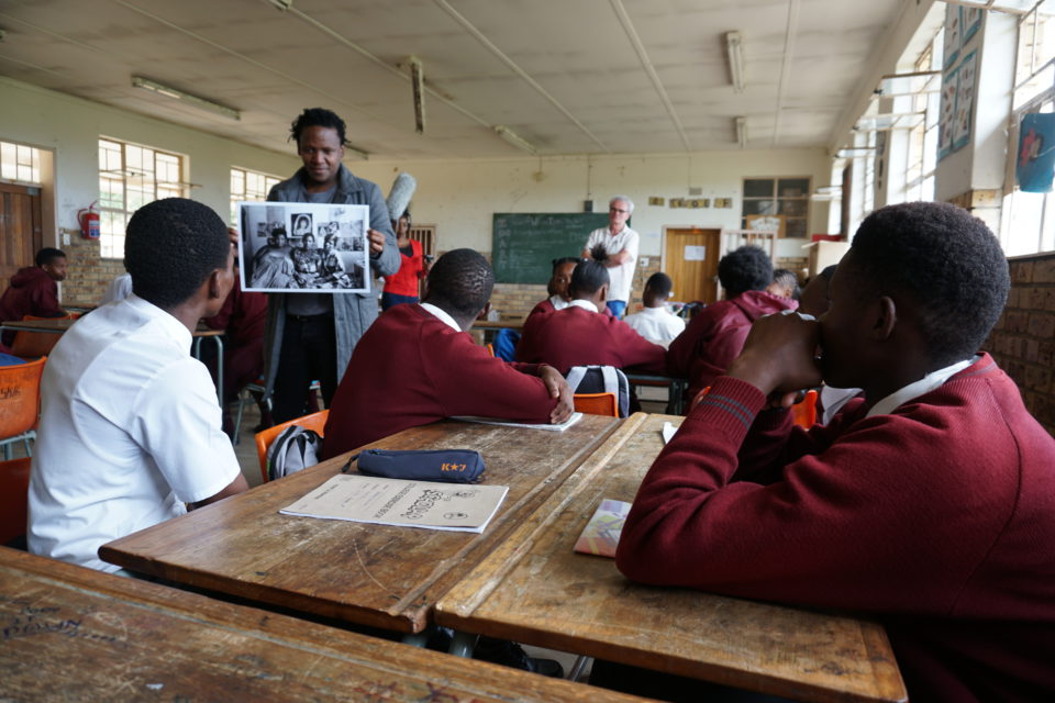 Lebo shows the photos of Welkom by Ad van Denderen at several schools in Welkom.