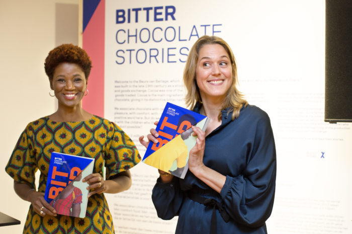 Photographer Joana Choumali and journalist Marijn Heemskerk receive the first copy of the photobook during the opening of the exhibition on 12 October 2017.