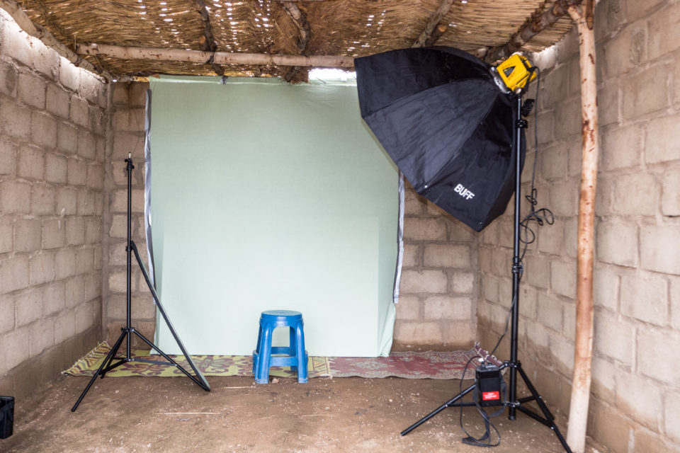 Pop-up photo studio in the shelter centre where the photos of the children are taken.