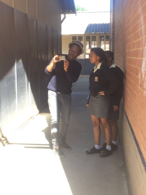Lebo explaining some photography skills to the students of Welkom Gimnasium.