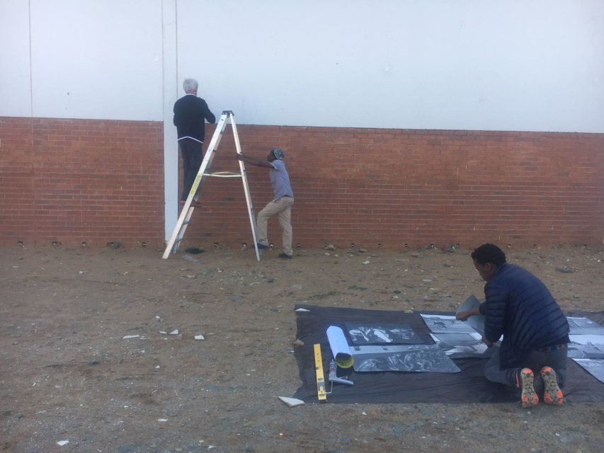 Setting up one of the pop-up exhibtions in the city center of Welkom.