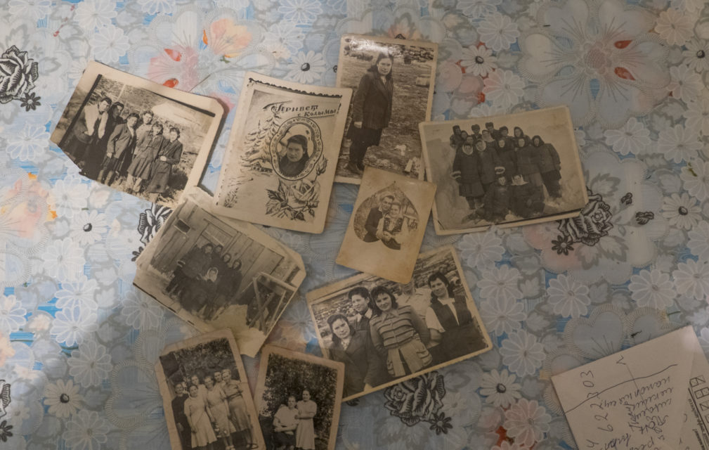 Photographs on the kitchen table of Antonia Novosad. On one of the postcards is written 'privet c Kolymy' which means 'greetings from Kolyma'.