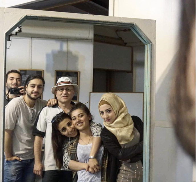 Issa Touma with members of Art Camping in the quest of finding the childhood home of one of them. The streets were so unrecognizable that it took them days to find it.