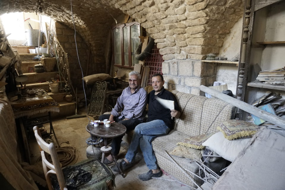 Walid Hinjo (left) his house was entirely destroyed with the exception of the basement. He conditioned it as temporary home while he rebuilds his house with the money from his retirement.