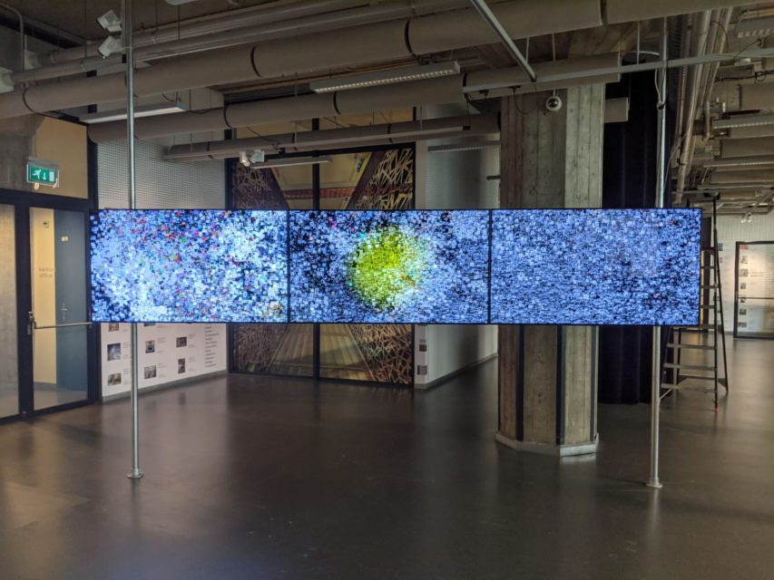 Three screen installation in the Collection Illuminated by...Artificial Intelligence